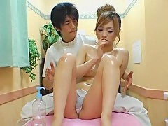 Oiled not far from Jap gets fingered in hidden cam massage relaxation