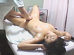 Busty babe toyed nicely in Japanese hidden cam massage video