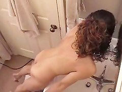 Lovable girl gets unvarnished and masturbates on the bath spy camera