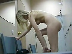 Absolutely uncovered blonde doing makeup on dressing room spy cam