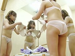 Dressing room girl puts insusceptible to tricot and fishnet pantyhose
