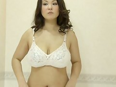 Fem with big tits tries to choose rub-down the lingerie on voyeur cam