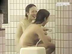 Asian girls in the pool and under shower on spy cam