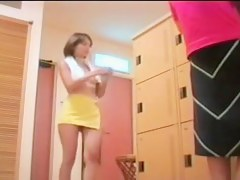 Brunette Asian in changing room changing her cloths