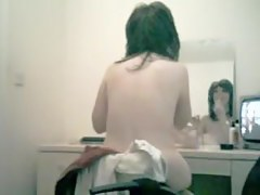 Asian spy cam beauty going to do makeup before mirror