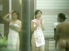 Asian cuties spied all naked from out of the bushes
