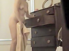Spy cam solo woman has covered very hairy cunt under panty