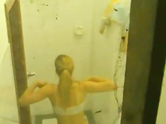 Perky breasted blonde caught in the shower by a window voyeur