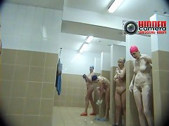 Wet wives under the shower caught on a spy xxx cam video