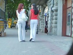Two ladies with sexy asses walking down the street