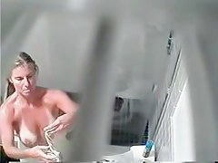 Tan lined female got her nude boobs on shower spy cam