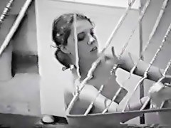 Nude Latin chick spied doing her laundry thru the window