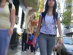 A duo of teen asses followed around the city by a voyeur cam