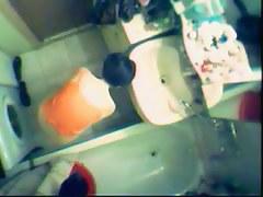 An enticing voyeur spy cam vid of a floozy in the shower