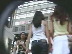 Candid street upskirt with hot brunette in white skirt