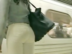 Street candid vid with tight white jeans on amazing ass