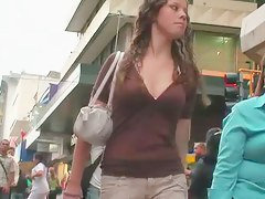 Curly chick with beautiful boobs is being a star in street candid