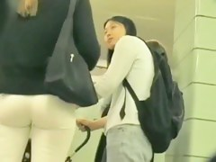 Hot blonde in tight white pants in this street cam video