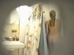 Sexy blonde chick on hidden shower cam