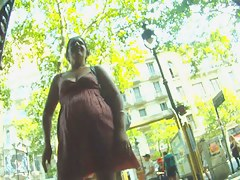 Public candid upskirt video of a girl wearing a short dress with no panties