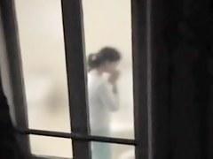 Peeking the nude amateur bimbo in the window