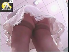 Cute babe with nice legs is filmed on a hidden cam