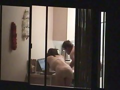 Voyeur window peep at a couple naked in their home
