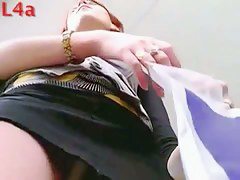 A redhead cutie gets her panties in a voyeur upskirt video