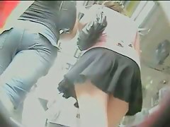 Lovely upskirt shot of wavy short skirt and tight jeans