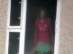 Voyeur my sexy nude neighbor in the window darkness