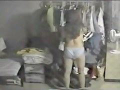 Sexy brunette in panty voyeured thru changing room window
