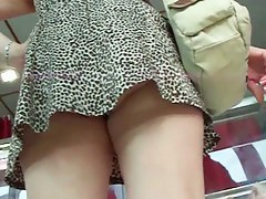Mature wife up skirt at the local market
