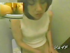Cutie on toilet cam is sliding the finger between pussy lips