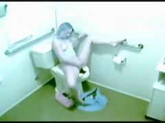 Voyeur masturbation video with long haired gal cumming in toilet