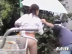 Rain and no panties sharking for a hot and sexy Asian girl