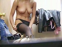Changing room amateur topless putting on stockings