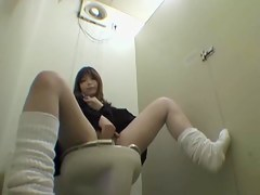 Asian girl is masturbating sitting on the toilet bowl DBAL007.HQ