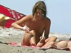 A voyeur catches a husband spanking his naked wife on the beach
