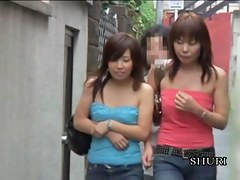 Boob sharking of two cute Japanese chicks on the street