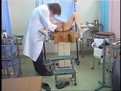 Kinky doc dildo penetrates Asian in the medical office