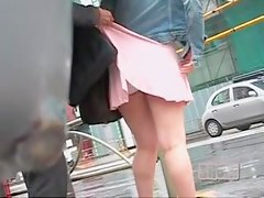 Asian babe has a accidental street sharking at a crosswalk.