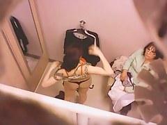 Goog looking girl choosing some underwear in a changing room