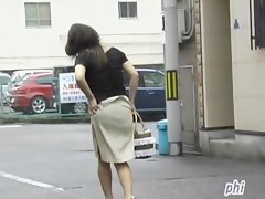 Asian milf almost lost her panties after skirt sharking