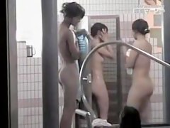 Asian girls are in public pool doing hot bodies exposure