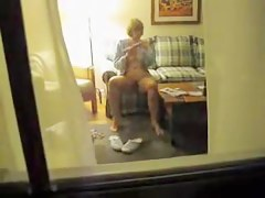 Mature amateur spied masturbating on the arm chair