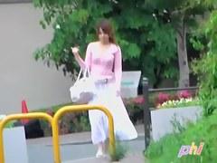 Pretty Asian girl walking down the path got top sharked