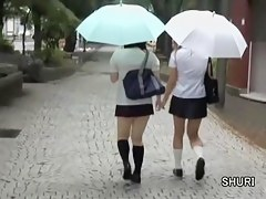 Two schoolgirls followed by skirt sharks on the road