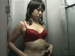 Asian slut is wearing red bra in the changing room