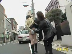 Asian babe has her pants removed by a expert street sharker.