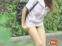 Hot Asian nurse gets a good street sharking outdoors.